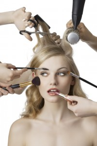 woman getting a beauty and hair style in the same time with hands performing different tasks